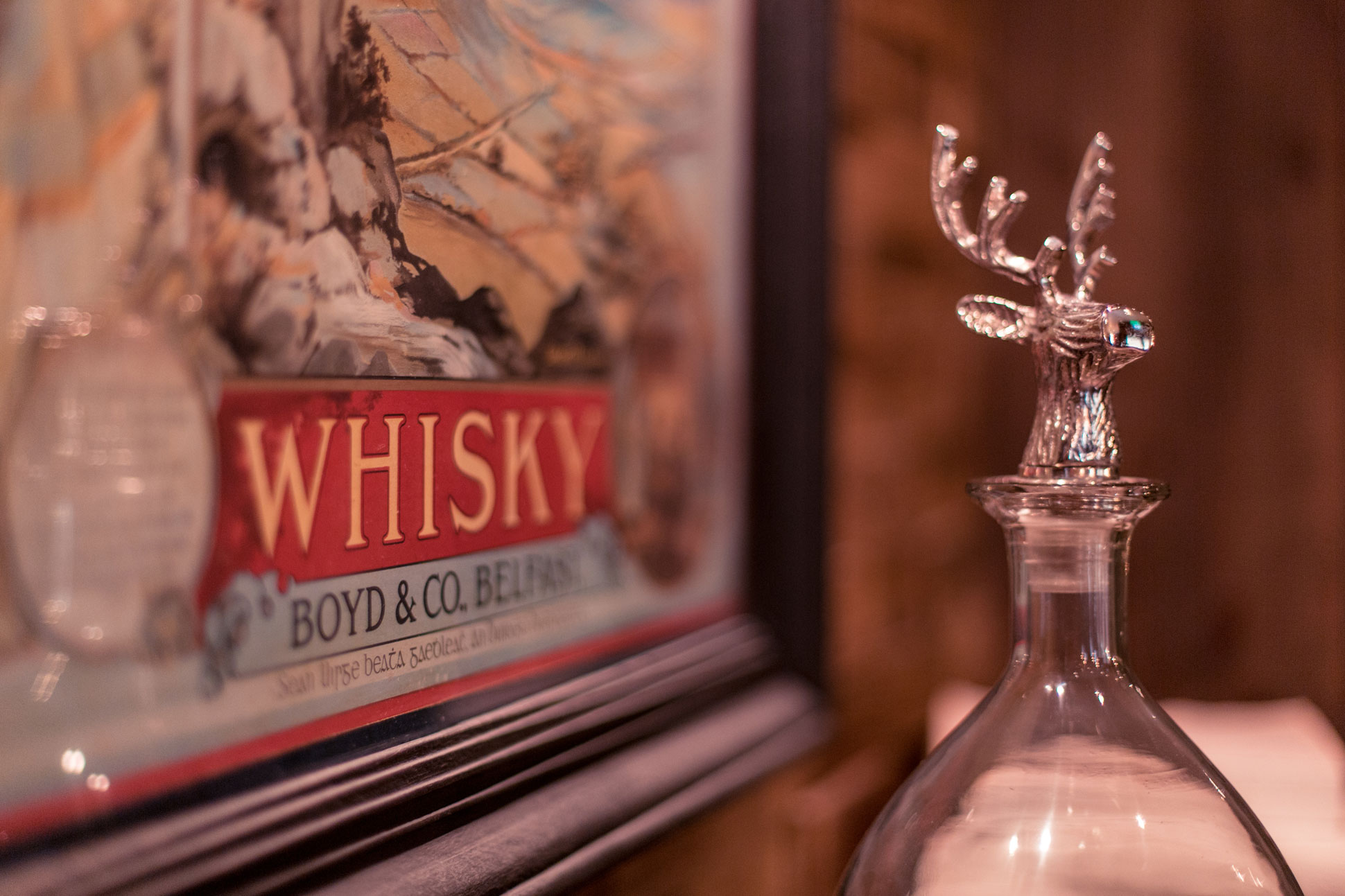 Vintage bar graphic with Stag head decanter